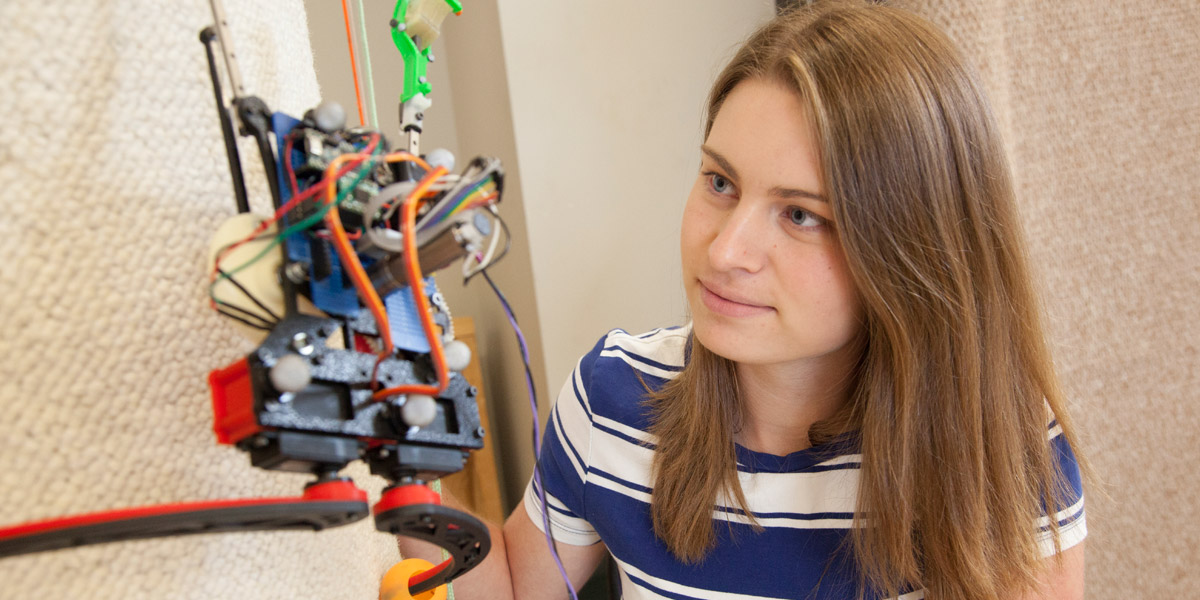 Female student observing a robotic spider