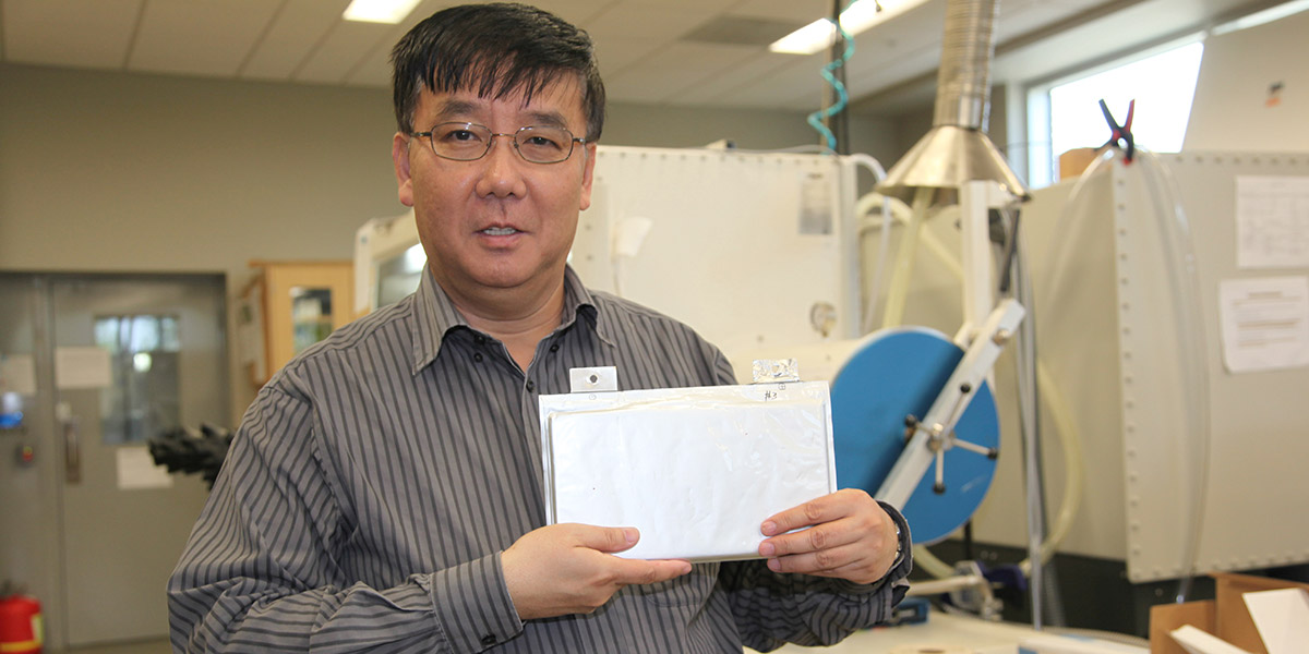 Dr. Zheng holding a new type of battery